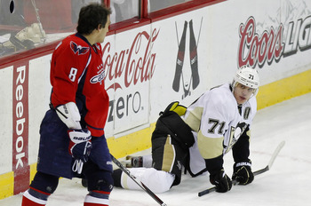 Alex Ovechkin keeping an eye on Evgeni Malkin.