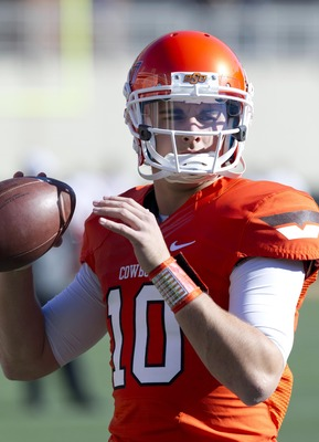 Nov 17, 2012; Stillwater OK, USA; Oklahoma State Cowboys quarterback Clint Chelf (10) warms up before the game against the Texas Tech Red Raiders at Boone Pickens Stadium.  Mandatory Credit: Richard Rowe-US PRESSWIRE