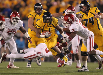 November 17, 2012; Morgantown, WV, USA; West Virginia Mountaineers wide receiver Tavon Austin (1) carries the ball on a 31 yard gain against the Oklahoma Sooners during the first quarter at Milan Puskar Stadium . Mandatory Credit: Charles LeClaire-US PRES