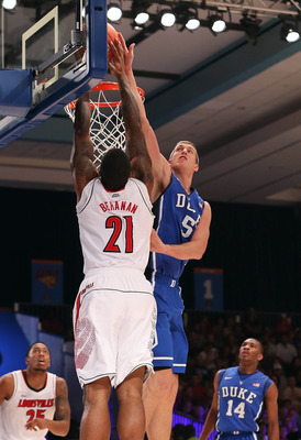 Nov 24, 2012; Paradise Island, BAHAMAS; Duke Blue Devils forward Mason Plumlee (5) blocks the shot of Louisville Cardinals forward Chane Behanan (21) during the 2012 Battle 4 Atlantis Championship in the Imperial Arena at the Atlantis Resort.  Mandatory C