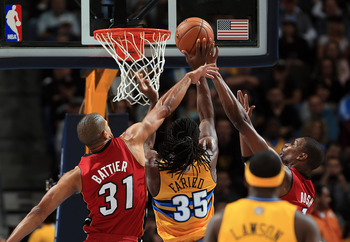DENVER, CO - NOVEMBER 15:  Kenneth Faried #35 of the Denver Nuggets tries to get off a shot against Shane Battier #31 and Chris Bosh #1 of the Miami Heat at the Pepsi Center on November 15, 2012 in Denver, Colorado. The Heat defeated the Nuggets 98-93. NO