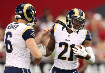 Jenkins (right) celebrates his second touchdown with punter Johnny Hekker.