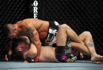 Hi-res-92325451-fighter-joe-stevenson-battles-with-ufc-fighter-spencer_display_image