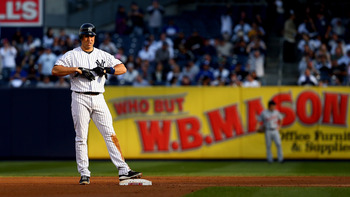 Mark Teixeira stands on second base during Game 2 of the ALCS against the Detroit Tigers