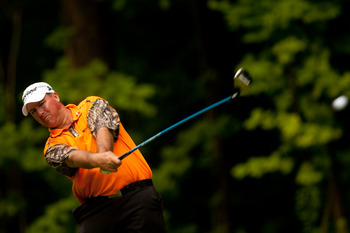 A shirt more suited to hunting than golf: orange and camo.