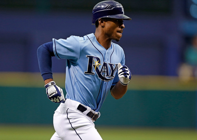 ST. PETERSBURG - SEPTEMBER 23:  Outfielder B.J. Upton #2 of the Tampa Bay Rays rounds the bases after his home run against the Toronto Blue Jays during the game at Tropicana Field on September 23, 2012 in St. Petersburg, Florida.  (Photo by J. Meric/Getty