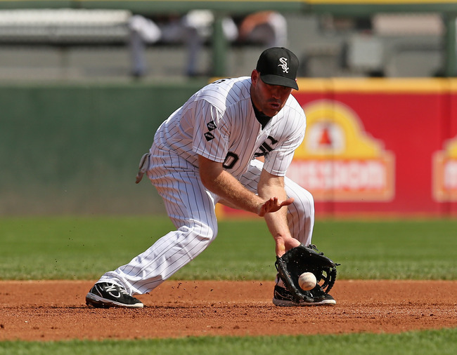 CHICAGO, IL - SEPTEMBER 25: Kevin Youkilis #20 of the Chicago White Sox fields a ball against the Cleveland Indians at U.S. Cellular Field on September 25, 2012 in Chicago, Illinois. The Indians defeated the White Sox 4-3. (Photo by Jonathan Daniel/Getty