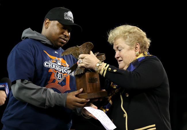 DETROIT, MI - OCTOBER 18:  (L-R) Delmon Young #21 of the Detroit Tigers receives his ALCS MVP trophy from Honorary American League President Jackie Autry after the Tigers won 8-1 against the New York Yankees during game four of the American League Champio