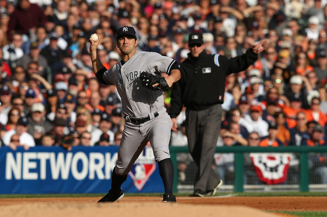 DETROIT, MI - OCTOBER 18:  Eric Chavez #12 of the New York Yankees throws the ball to first against the Detroit Tigers during game four of the American League Championship Series at Comerica Park on October 18, 2012 in Detroit, Michigan. The Tigers won 8-