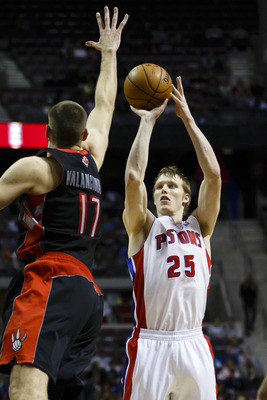 November 23, 2012; Auburn Hills, MI, USA; Detroit Pistons small forward Kyle Singler (25) shoots the ball over Toronto Raptors center Jonas Valanciunas (17) in the fourth quarter at The Palace. Detroit won 91-90. Mandatory Credit: Rick Osentoski-US PRESSW
