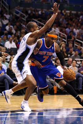 Arron Afflalo guards New York's Carmelo Anthony.