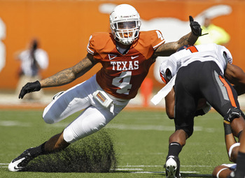 AUSTIN, TX - OCTOBER 15:  Safety Kenny Vaccaro #4 of the Texas Longhorns attempts a first quarter tackle of running back Joseph Randall #1 of the Oklahoma State Cowboys on October 15, 2011 at Darrell K. Royal-Texas Memorial Stadium in Austin, Texas.  Okla