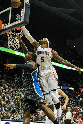 Josh Smith jumps over Glen Davis for a rebound.