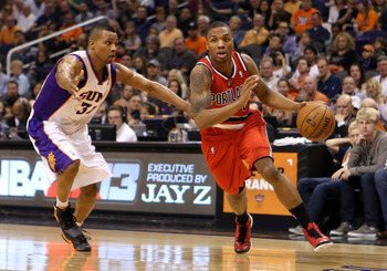 Sebastian Telfair (left) attempts to defend Damian Lillard (right)