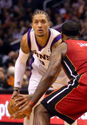 Michael Beasley (left) surveys the court against LeBron James (right) of the Miami Heat