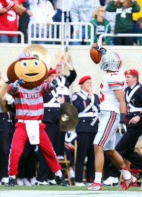 Devin Smith celebrates TD with Brutus and Ohio State's band.