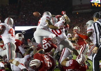 Ryan Shazier met Wisconsin runningback Montee Ball above the pile and knocked the ball out.