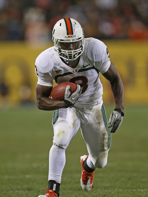 CHICAGO, IL - OCTOBER 06:  Duke Johnson #8 of the Miami Hurricanes runs against the Notre Dame Fighting Irish at Soldier Field on October 6, 2012 in Chicago, Illinois. Notre Dame defeated Miami 41-3.  (Photo by Jonathan Daniel/Getty Images)