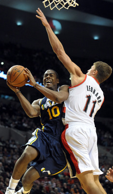 Oct 22, 2012; Portland, OR, USA; Utah Jazz point guard Alec Burks (10) drives to the basket on Portland Trail Blazers center Meyers Leonard (11) in the third quarter of the game at the Rose Garden. The Blazers won the game 120-114. Mandatory Credit: Steve