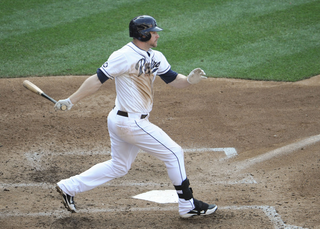 SAN DIEGO, CA - AUGUST 29:  Chase Headley #7 of the San Diego Padres hits a  two RBI single during the fifth inning of a baseball game against the Atlanta Braves at Petco Park on August 29, 2012 in San Diego, California.   (Photo by Denis Poroy/Getty Imag