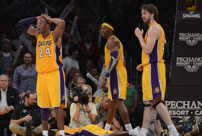 LOS ANGELES, CA - NOVEMBER 27:  Kobe Bryant #24, Dwight Howard #12 and Pau Gasol #16 of the Los Angeles Lakers react to a blocking foul on Chris Duhon #21 during the game against the Indiana Pacers at Staples Center on November 27, 2012 in Los Angeles, Ca