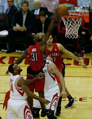 Cook stand by as Terrence Ross slams home one of his five awesome dunks.