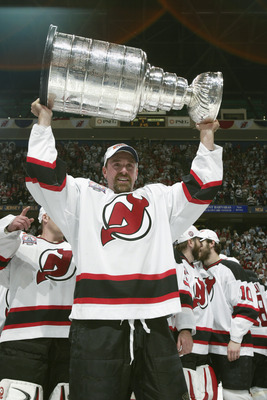 Joe Nieuwendyk hoisting the Stanley Cup.
