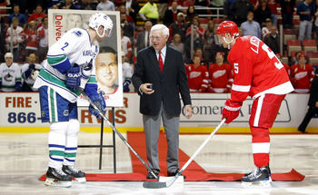 Alex Delvecchio dropping the puck for a game between his beloved Red Wings and the Canucks.