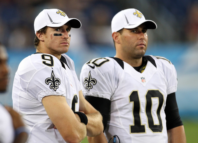 NASHVILLE, TN - AUGUST 30: Drew Brees #9 and Chase Daniel #10 of the New Orleans Saints watch the action from the sideline against the Tennessee Titans at LP Field on August 30, 2012 in Nashville, Tennessee.  (Photo by Joe Murphy/Getty Images)