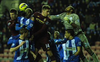 Nastasic (left) vies for the header