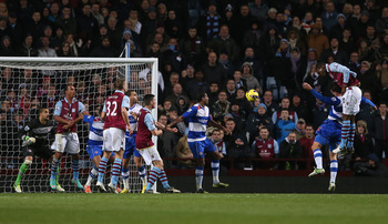 Benteke (right) leaps to obtain a headed goal