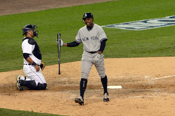 Curtis Granderson heads back to the bench after striking out during Game 4 of the 2012 ALCS against the Detroit Tigers
