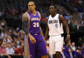 Shannon Brown (left) and Darren Collison (right) of the Dallas Mavericks look on during a 2012 preseason game