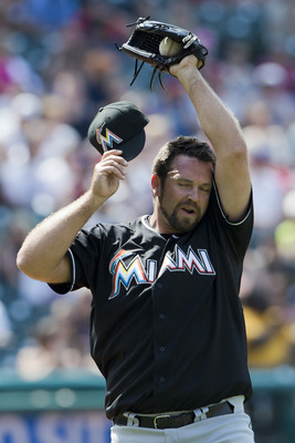 Marlins closer Heath Bell wipes his sweat off against Cleveland.
