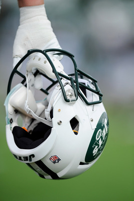 FLORHAM PARK, NJ - AUGUST 07:  A member of the New York Jets holds his helmet during practice at NY Jets Practice Facility on August 7, 2011 in Florham Park, New Jersey.  (Photo by Patrick McDermott/Getty Images)