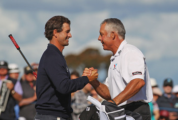 Adam Scott is congratulated by caddie Stevie Williams.