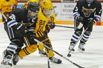 Hannah Brandt and Minnesota State forward Kari Lundberg battle for the puck at Ridder Arena, Image By Ichigo Takikawa http://www.mndaily.com/2012/11/19/gophers-set-winning-streak-record-sweep