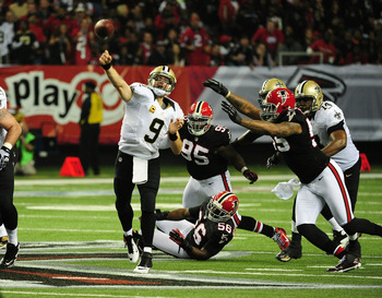 Drew Brees throws five interceptions at Atlanta to end playoff hopes.
