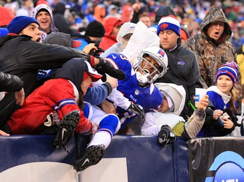 Steve Johnson celebtates third quarter TD catch with fans.