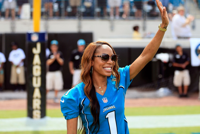 JACKSONVILLE, FL - SEPTEMBER 16:  Olympic gold medal winner Sanya Richards-Ross acknowledges fans during the game against the Houston Texans at EverBank Field on September 16, 2012 in Jacksonville, Florida.  (Photo by Sam Greenwood/Getty Images)