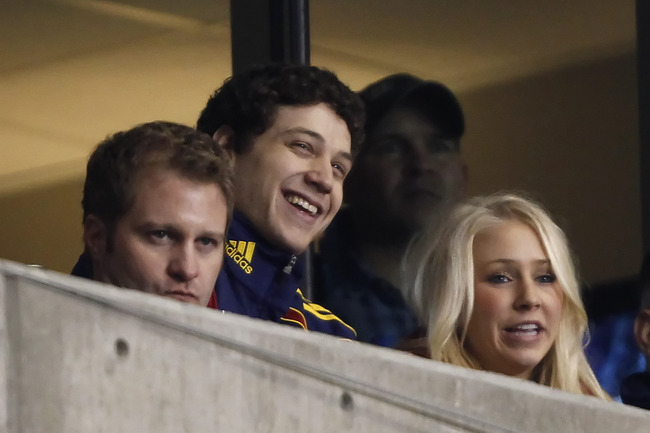 SANDY, UT - MARCH 26: Former BYU basketball player Jimmer Fredette (C) smiles with his girlfriend Whitney Wonnacott (R) during a game against Real Salt Lake and the Los Angeles Galaxy during the second half of an MLS soccer game March 26, 2011 at Rio Tint