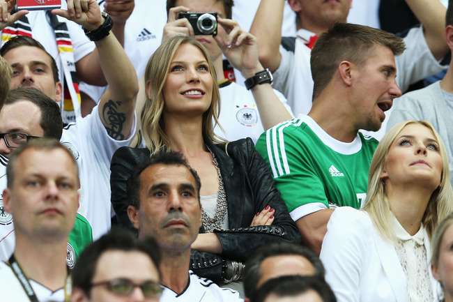 WARSAW, POLAND - JUNE 28:  Sarah Brandner (C), girlfriend of Bastian Schweinsteiger and Lena Gercke (bottom R), girlfriend of Sami Khedira of Germany look on before the UEFA EURO 2012 semi final match between Germany and Italy at the National Stadium on J