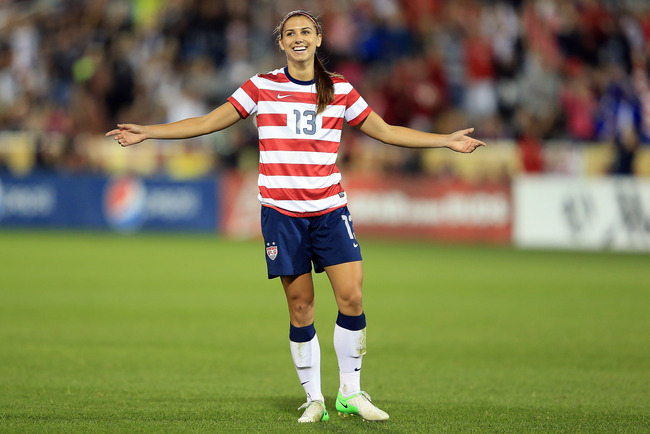 COMMERCE CITY, CO - SEPTEMBER 19:  Alex Morgan #13 of the USA celebrates her goal against Australia at Dick's Sporting Goods Park on September 19, 2012 in Commerce City, Colorado. The USA defeated Australia 6-2.  (Photo by Doug Pensinger/Getty Images)