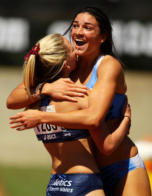 SYDNEY, AUSTRALIA - MARCH 16:  Michelle Jenneke (R) of NSW celebrates with 2nd placegetter Abble Taddeo (L) of NSW after winning the Womens U20 100m Hurdles Final during day three of the Australian Junior Athletics Championships at Sydney Olympic Park Ath