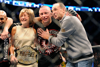 Nov 17, 2012; Montreal, QC, Canada;  Georges St-Pierre poses for a photo with his parents Pauline and Roland after winning the Welterweight Championship bout against Carlos Condit at UFC 154 at the Bell Centre.  St-Pierre defeated Condit by unanimous deci