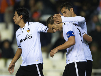 VALENCIA, SPAIN - NOVEMBER 07: Roberto Soldado of Valencia celebrates with his team-mates Jonas (R) and Tino Costa after scoring his team's second goal during the UEFA Champions League group F match between Valencia CF and FC BATE Borisov at Estadi de Mes