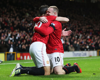 MANCHESTER, ENGLAND - NOVEMBER 28:  Robin van Persie of Manchester United (L) celebrates with Wayne Rooney of Manchester United as he scores their first goal during the Barclays Premier League match between Manchester United and West Ham United at Old Tra