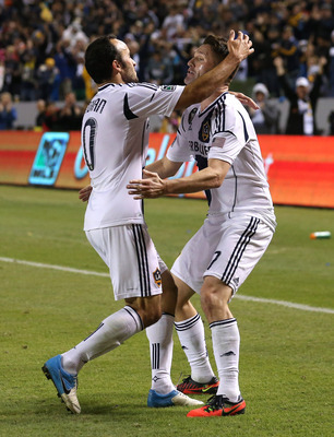 CARSON, CA - NOVEMBER 11:  Robbie Keane #7 and Landon Donovan #10 of the Los Angeles Galaxy celebrate Keane's goal in extra time of the first half against the Seattle Sounders in Leg One of the Western Conference Championship at The Home Depot Center on N
