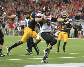DETROIT, MI - NOVEMBER 30:  Jordan Lynch #6 of the Northern Illinois Huskies scores a second-half touchdown against the  Kent State Golden Flashes during the Mid-American Conference Championship game at Ford Field on November 30, 2012 in Detroit, Michigan