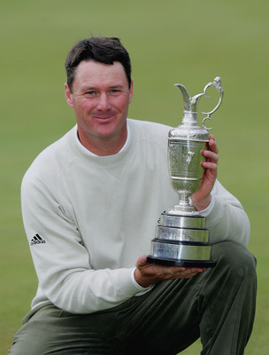 Todd Hamilton holds the Claret Jug as the 2004 Champion Golfer of the Year